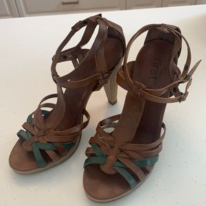 Strappy brown and teal leather heels.